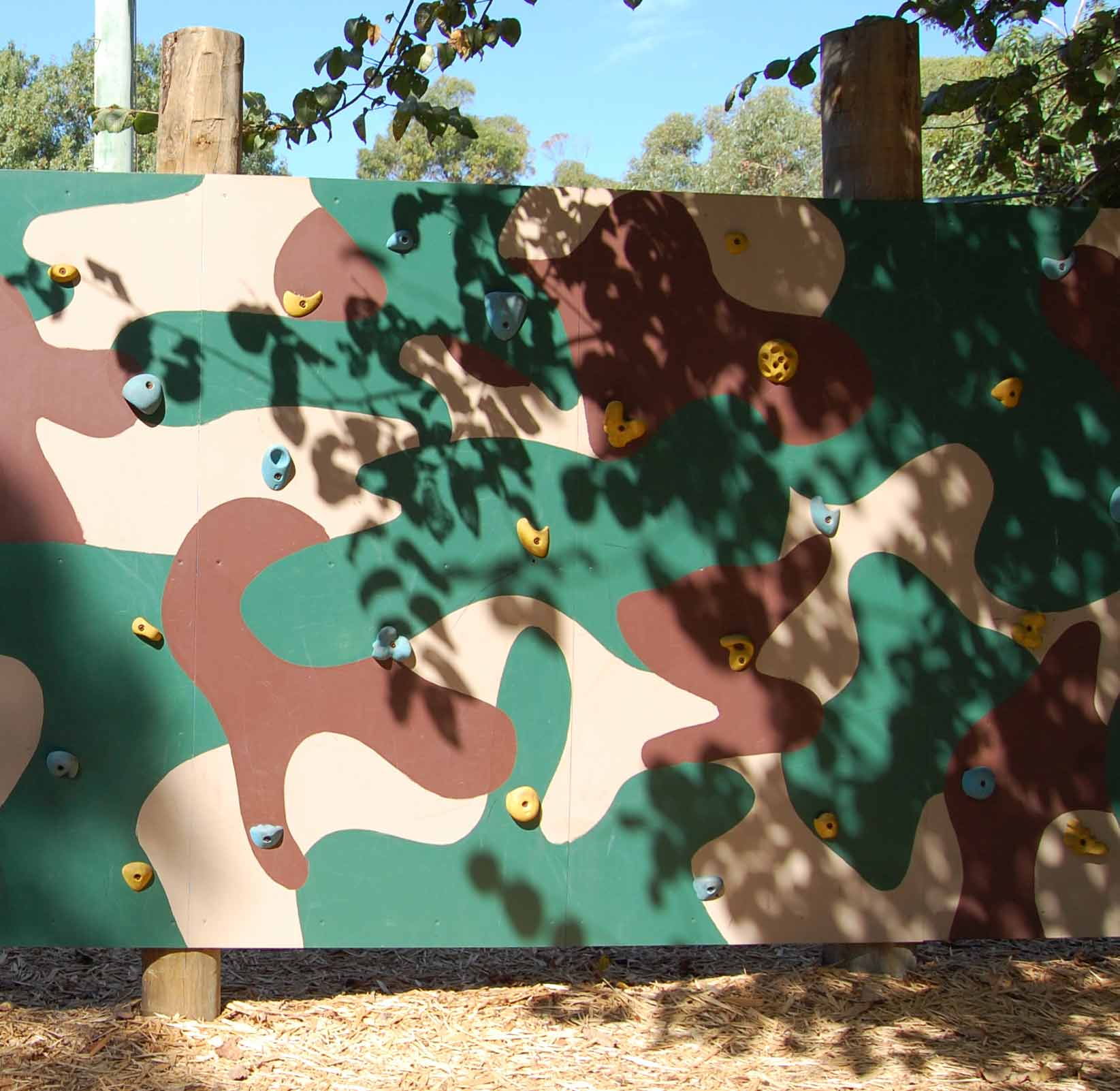 The traversing wall is painted in camouflage colours